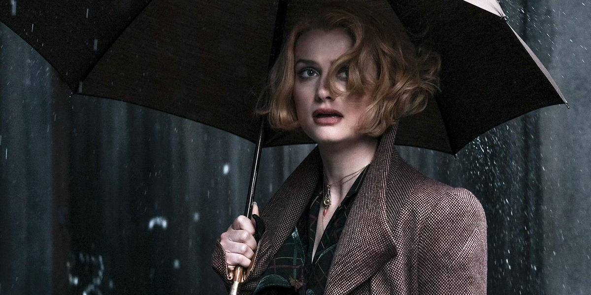 Why did Queenie join Grindelwald